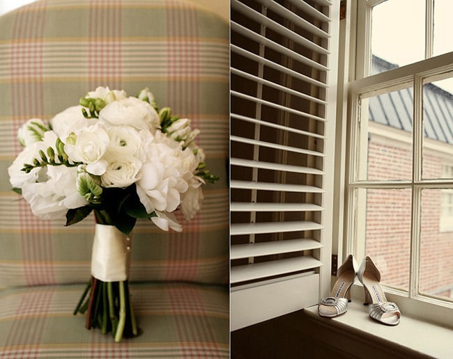 Gorgeous white flower bouquet standin upright on checkered plush chair.