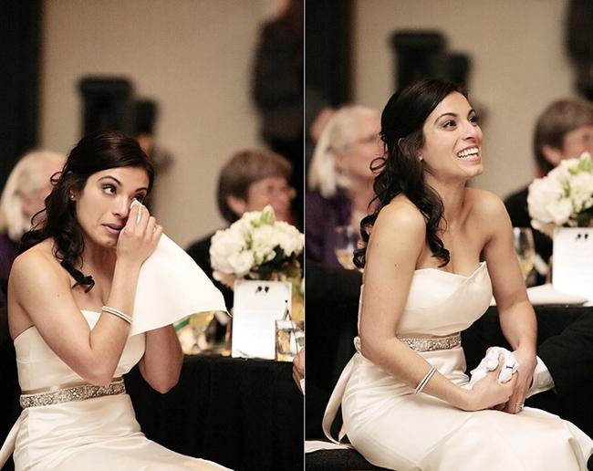 bride wiping away a happy tear at wedding reception
