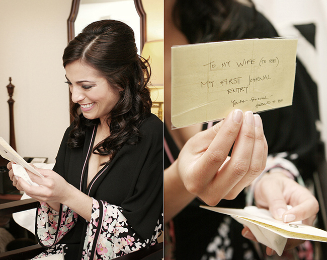 bride laughs as she reads card from her groom