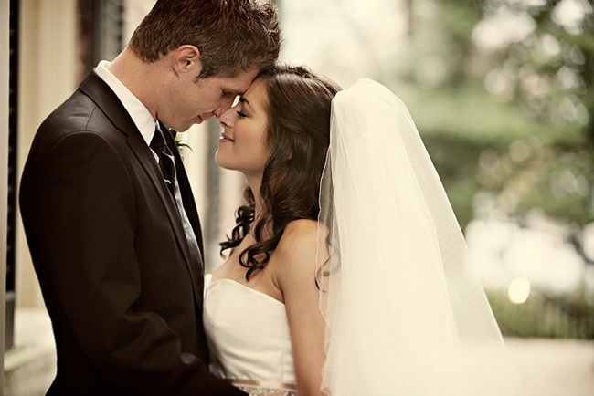 bride and groom touch nose-to-nose at first look