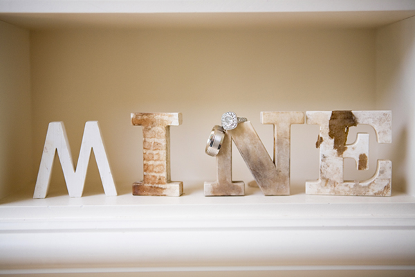 "block letters ""MINE"" with wedding bands on the N"