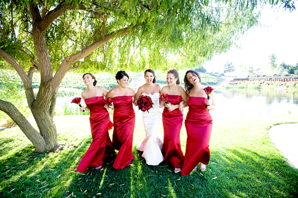 bridesmaids in bright red satin gowns