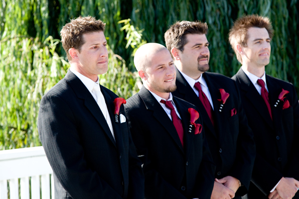 groom and groomsmen stand at front of ceremony