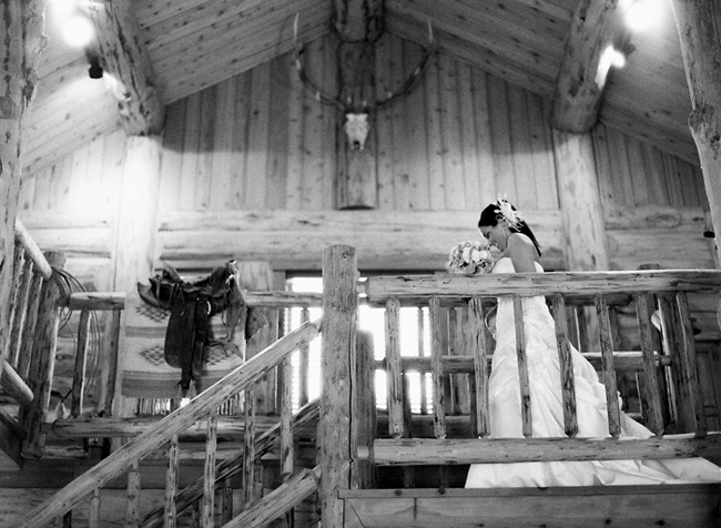 Black and White photo of bride at top of landing - log wood chalet