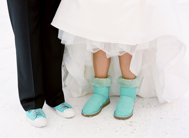 Bride and grooms matching aqua blue colored footwear