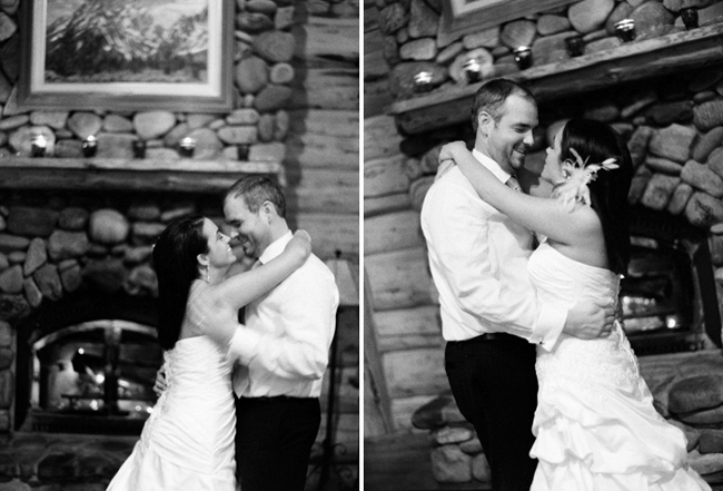 black and white photo of bride and groom in front of fireplace