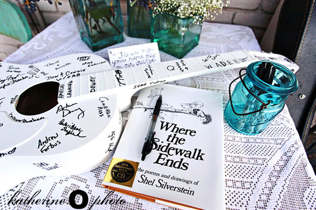 Guitar guest book at wedding reception and where the sidewalk ends by shel silverstein for guest book and clear mason jar on white embroidered table cloth