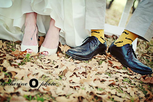 Bride wearing white peep toe heels Groom in black dress shoes and yellow socks