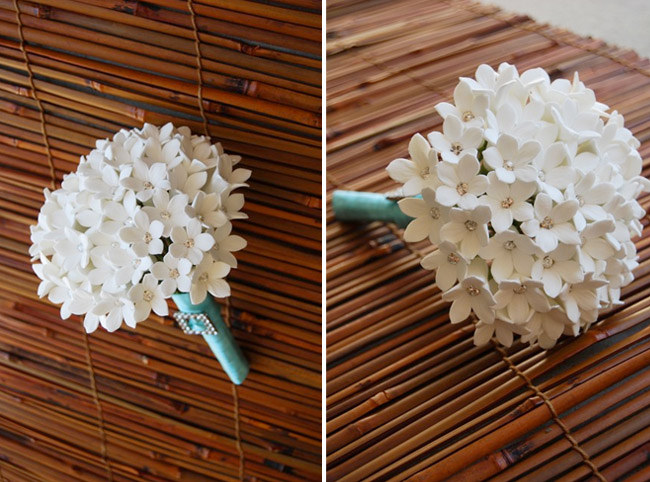 Bridal bouquet composed of white clay stephanotis flowers and Swarovski crystals