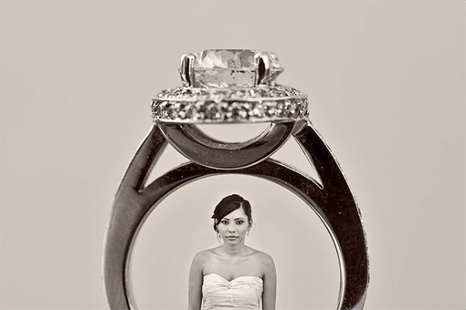 Round diamond engagement ring with halo and picture of a bride standing in the ring