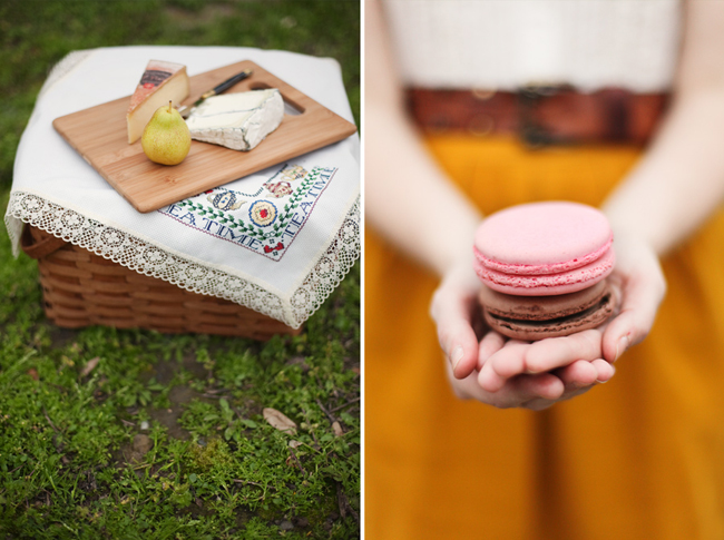 Picnic basket with napkin and wooden cheese board with 2 types of cheeses and a green pear (left photo); girl in mustard colored dress holding a pink and brown macaroon (right photo)