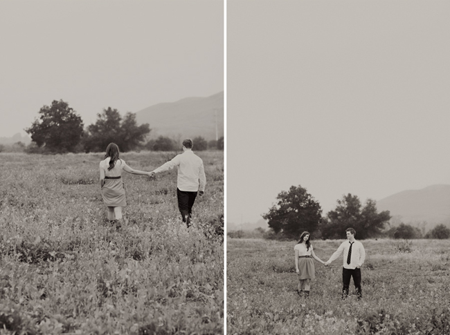 Black and white picture of engaged couple holding hands standing in a field of mustard flowers with their back to the camera (left photo);black and white photo of engaged couple holding hands facing the camera standing in field (right photo)