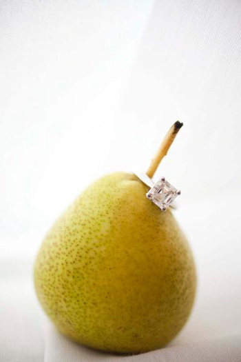 Princess cut engagement ring on a green pear stem
