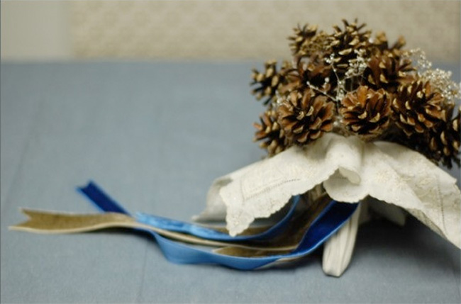 Bridal bouquet made of glittered pine cone bouquet