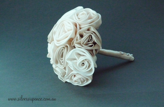 Tan and white bridal bouquet made of handcrafted fabric roses.