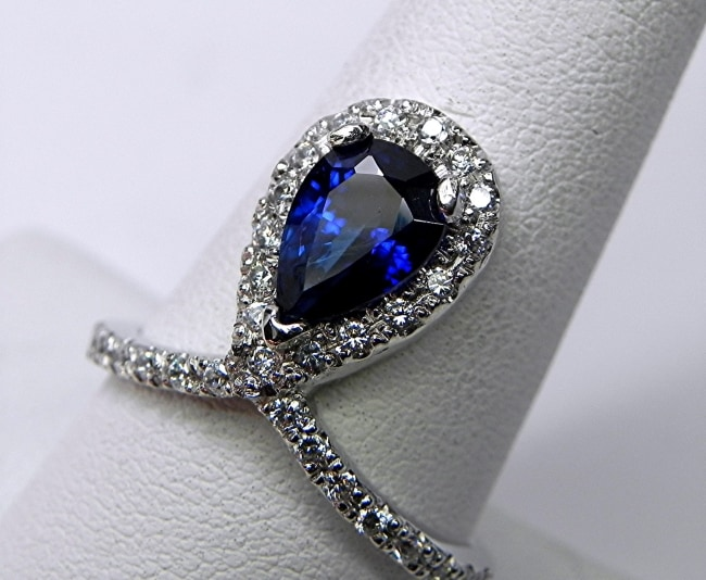 Unique Blue Sapphire engagement ring with halo