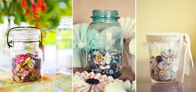 Mason jar, cup full of multi-color and different sized buttons in Button Themed Wedding Inspiration
