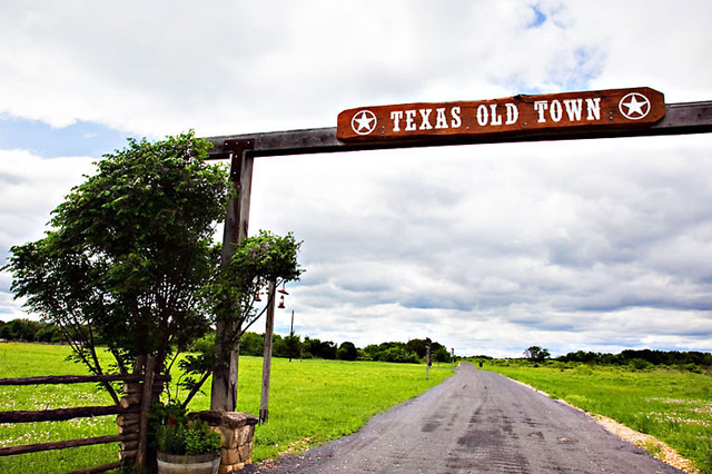 Long roadway leading to wedding venue - Texas Old Town