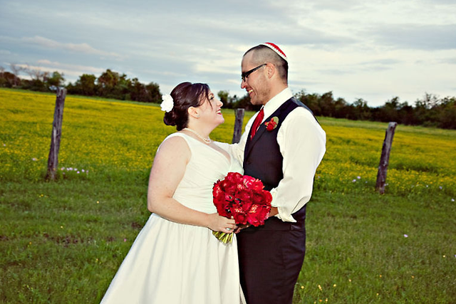 bride and groom in open field of the Ranch