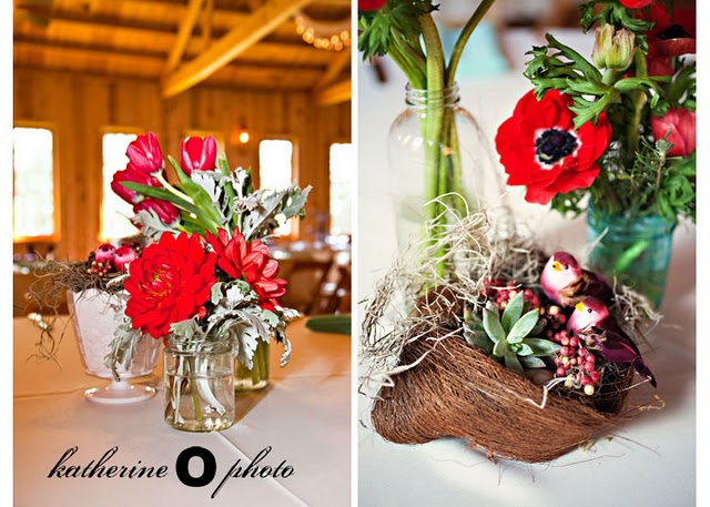 red flowers in vases and little bird cage nests
