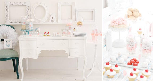 Wedding dessert table idea - DIY white vanity dessert table set against a white wall. Red Cherries on cupcakes give a pop of color