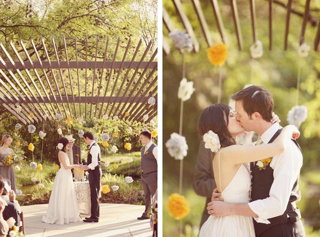 bride and groom kiss at wedding ceremony at Umluaf Sculpture Garden