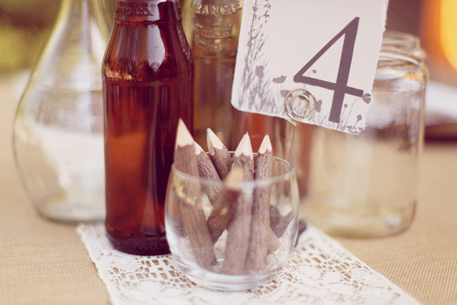 wood stick pencils in glass with table number for wedding at Umluaf Sculpture Garden