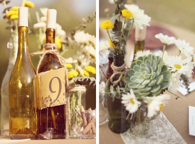 wine bottle decor with succulent and daisy flower centerpieces at wedding at Umluaf Sculpture Garden