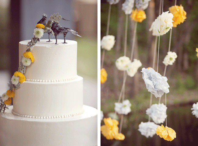 crow cake toppers on three-tier white wedding cake