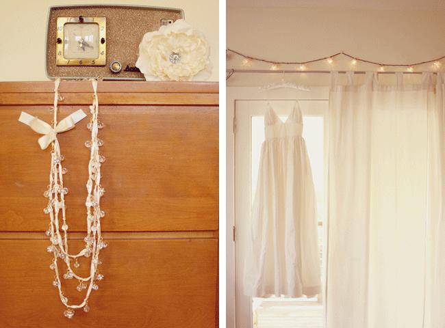 Brides white dress hanging on rod