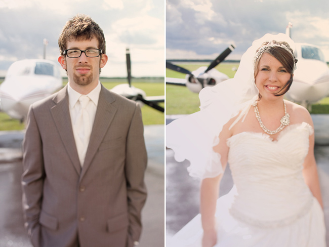 bride and groom standing in front of airplane