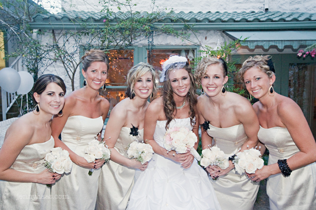 bridesmaids wore cream-colored dresses with black jewellery accessories