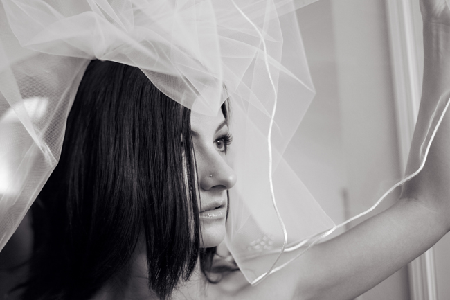 black and white photo of tulle veil above bride's head