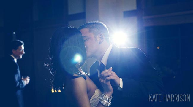 bride and groom dance with spotlight background
