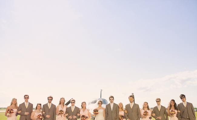 aviation themed wedding bridal party in a line wearing aviator sunglasses