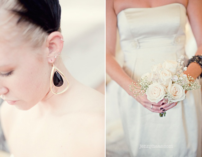 black dangling earrings and black feather hairpiece; bridal bouquet