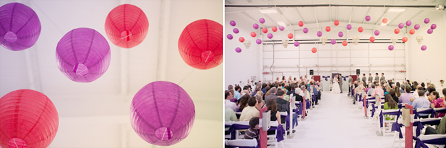 purple and red paper lantern decorations in airplane hanger wedding ceremony