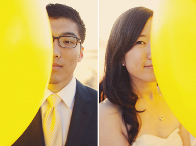 Sharon and Alex each hide behind a yellow balloon