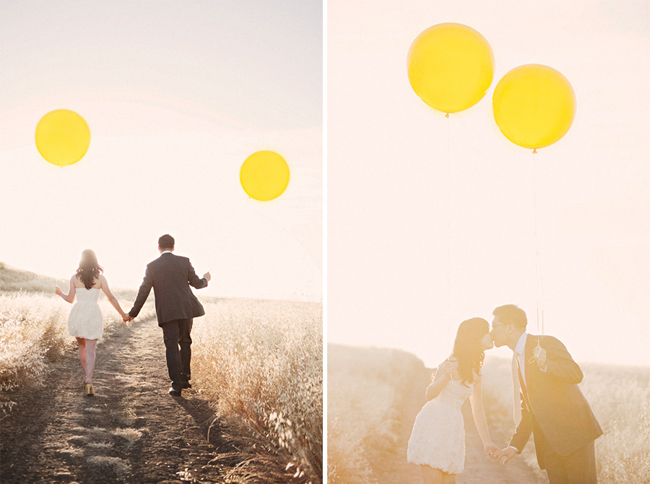 Sharon and Alex kiss while holding two giant yellow balloons