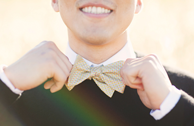 Alex adjusting his polka dot bow tie