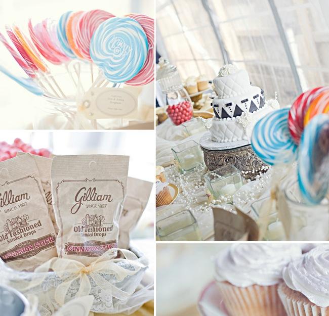 lollipop favors; white wedding cake with black trim; white cupcakes