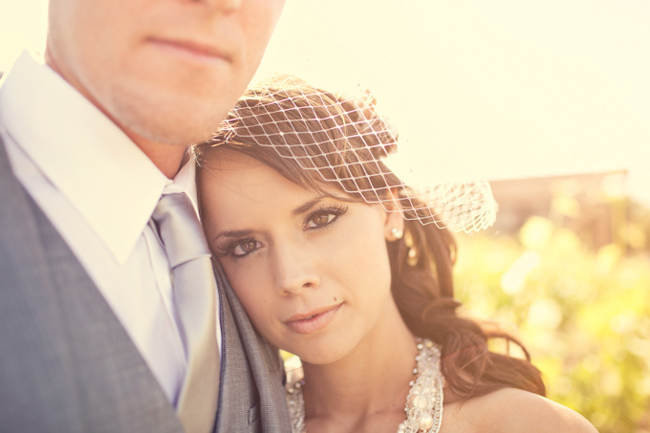 closeup of bride laying head on groom's shoulder