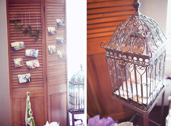 photos hanging on door; gilded bird cage