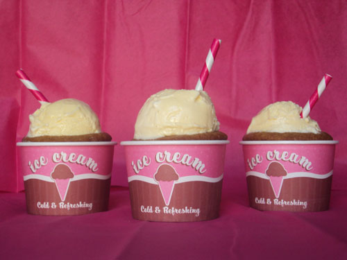 Root beer float cupcakes in pink and brown ice cream cups