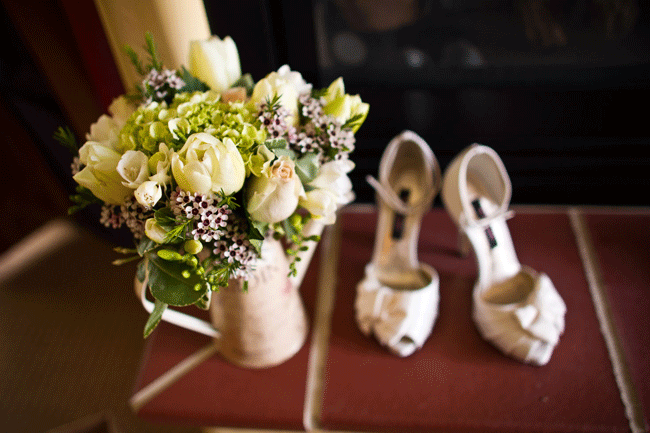 floral bouquet with brides shoes on floor
