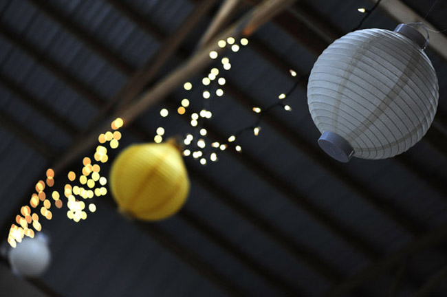 paper lanterns hanging from barn rafters