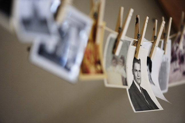 old family photos hanging from clothespins