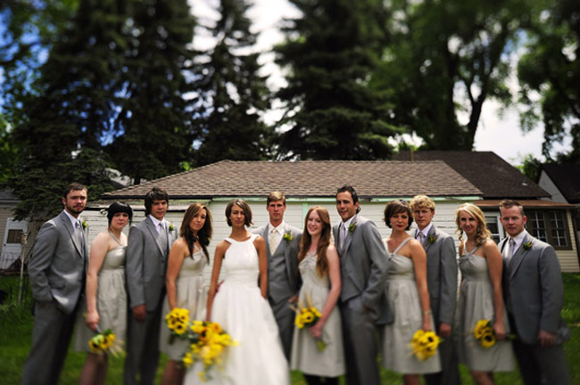 bridal party dressed in gray suits for the men and light green for bridesmaids
