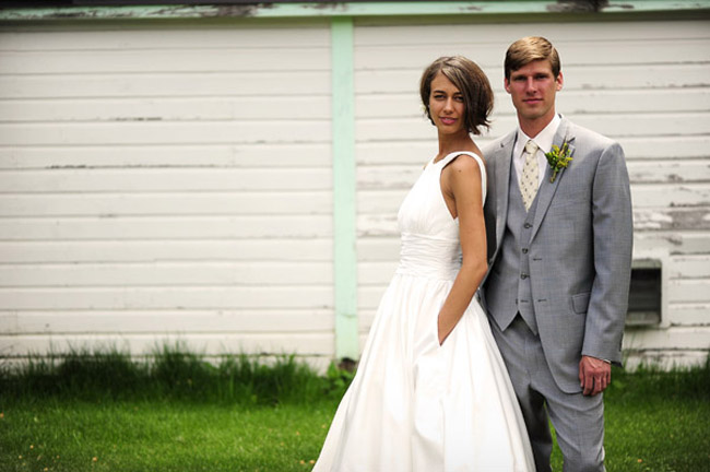 bride in white dress and groom in gray suit