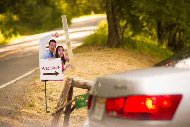 Beverley and Matthew's photo on a sign directing guests to the wedding